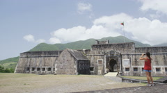 Tourist visiting St. Kitts Brimstone Hill Fortress - Caribbean destination - stock footage