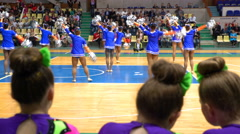 Spectators and competitors are rooting for their cheerleading team. - stock footage