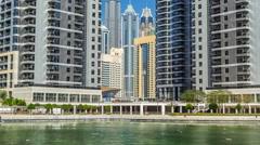 Residential buildings in Jumeirah Lake Towers timelapse in Dubai, UAE Stock Footage