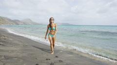 St. Kitts Beach - Bikini girl walking Saint Kitts Caribbean cruise destination Stock Footage