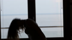 dancing silhouette in front of a window - stock footage