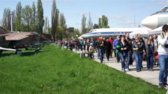 Large crowd enjoying plane and jet exhibition, many people walking outdoors Stock Footage