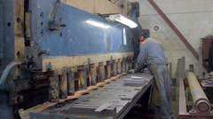 Man is working on a metal press machine on a factory Stock Footage