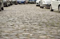 Stone Paved Street and Cars - stock photo