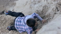 portrait of a little boy in a plaid shirt on sand quarry - stock footage