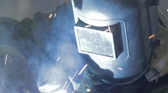 Welding light on a worker close-up front view Stock Footage