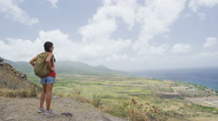 Hiking travel woman looking at St Kitts landscape - tourist destination Stock Footage