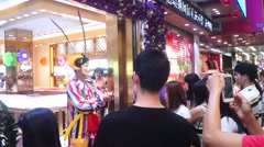 Gold jewelry store promotions, clown performances to attract people - stock footage