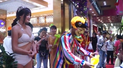 Gold jewelry store promotions, clown performances to attract people Stock Footage