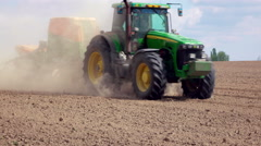Modern tractor moves with sowing machine - stock footage