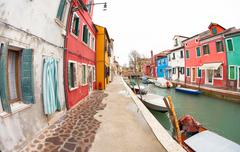 wide view on colorful houses from a secondary street in Burano - stock photo