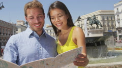 Tourists couple with map in Madrid sightseeing in Spain Stock Footage