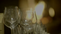 Vine glasses near fireplace romantic dinner drink Stock Footage