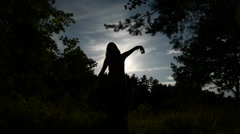 Dancing girl silhouette against the sky - stock footage