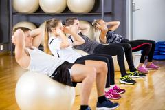 Group does abdominal exercises for core strength Stock Photos