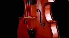 Violin or viola instrument turning at black background - stock footage