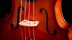 Violin or viola instrument turning at black background Stock Footage