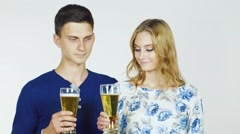 Man and woman with beer glasses on a white background Stock Footage