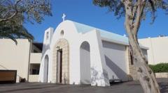 Hugged senior couple enter greek church Stock Footage