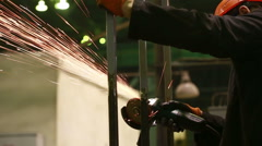 Electric wheel grinding on steel structure in factory Stock Footage