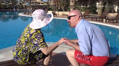 Romantic kiss of senior couple on vacation - stock footage