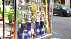 Shisha smoking hookahs in display cabinet with street background Stock Footage