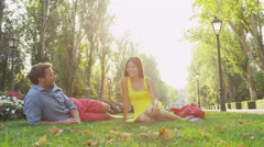 Romantic couple enjoying weekend in city park Stock Footage