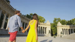 People walking in Madrid in El Retiro park - Couple holding hands Stock Footage