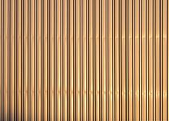 Aluminum golden corrugated metal wall - stock photo