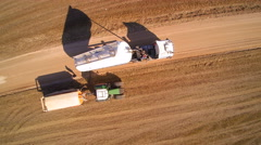 Aerial shot of the two trucks on the field Stock Footage