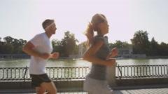 Runners jogging running in Madrid El Retiro park Stock Footage