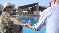 Romantic senior couple holding hands - stock footage