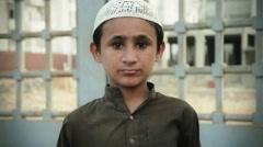 Innocent little Boy looks at the camera, Pakistan - stock footage