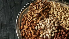 Nut: Pistachios, almonds, cashews , hazelnuts , walnuts on dark wooden backgroun - stock footage