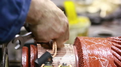 Mechanic repairing electric generator, repair of starter. motor mechanic repairs - stock footage