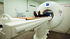 MRI machine and screens with doctor and nurse - stock footage