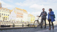 Copenhagen people - couple walking in Nyhavn Denmark Stock Footage