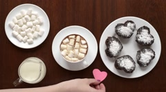 Putting paper hearts on a coffee table Stock Footage