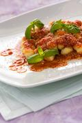 Gnocchi, Italian pasta with tomato sauce basil and grana cheese Stock Photos
