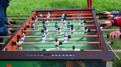 Children playing table football (soccer), closeup of board with moving players Stock Footage