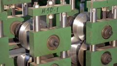 Rolling machine is bending metal tape  Stock Footage