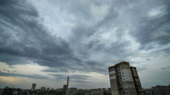 The flow of cloud on a background of the city. Time lapse Stock Footage