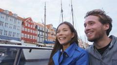 Copenhagen tourists people on boat tour of Nyhavn - famous tourist activity Stock Footage
