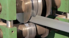 rolling machine is bending metal tape  - stock footage