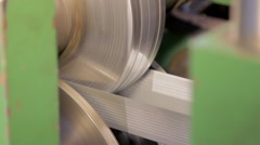 Rolling machine is bending metal tape close-up Stock Footage
