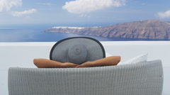 Vacation travel woman relaxing enjoying Santorini looking at view of Caldera Stock Footage