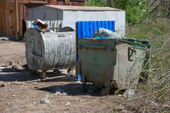 City trash cans in slum area - stock photo