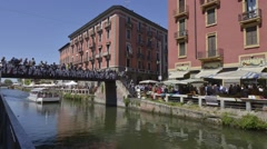 Antiques market on the banks of Naviglio Grande in Milan. Time lapse. Stock Footage