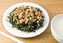 Chinese Traditional Food, Stir Fried Jute Leaves or Mulukhiyah Leaves with Mi Stock Photos