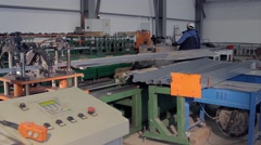Metal cutting machine and workers Stock Footage